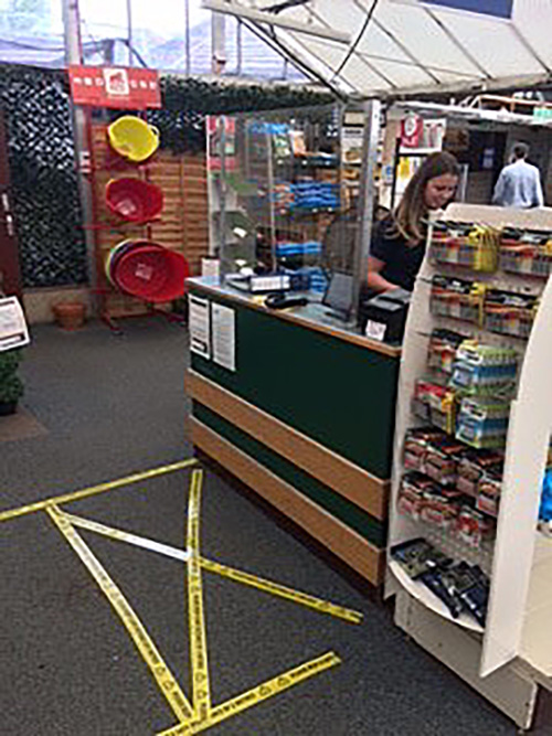 Covid-19 safety measures at checkouts inside Oxford Garden Centre