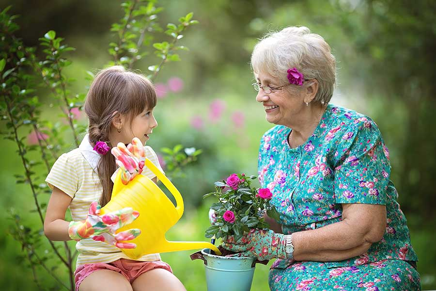 Child gardening with Grandmother